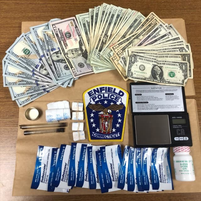 Forty-five bags of heroin and cash were seized following a domestic incident in Connecticut.