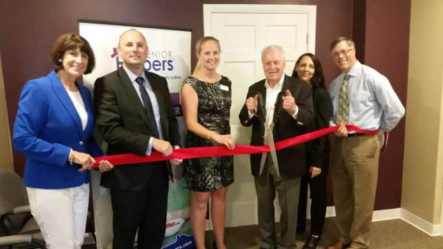 Fairfield Chamber of Commerce President Beverly Balaz, co-owners Joel and Katie Vanovitch, First Selectman Michael Tetreau, General Manager Lynn Lemay and Fairfield Director of Community and Economic Development Mark Barnhart cut the ribbon.