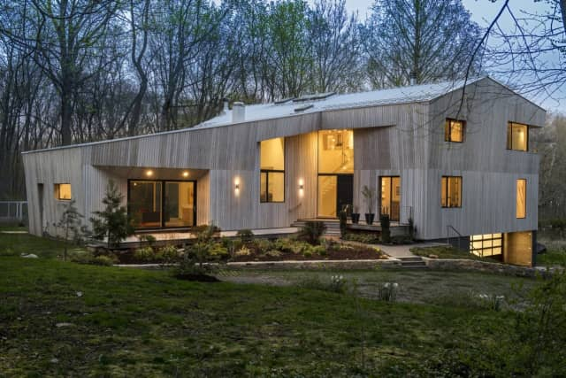 A contemporary Darien resident, listed with agent Molly O'Brien Watkins, is offered at $3.39 million.
