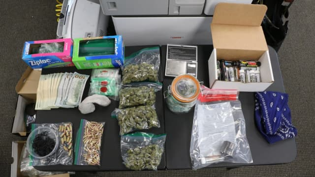 Norwalk police seized pot, cash and a gun during a bust.