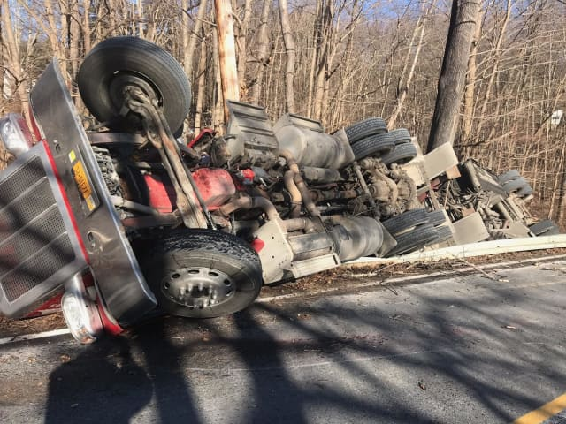 A rollover crash of a tractor-trailer carrying a large amount of fuel has closed Route 116.