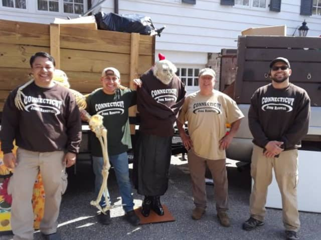 From left to right the Connecticut Junk Removal Crew: Harry, Juan, Glen Jennings and Raul Carbuccia (sales manager) with a crazy ghoul they found in the attic of the clean-out  and dressed in a company t-shirt.