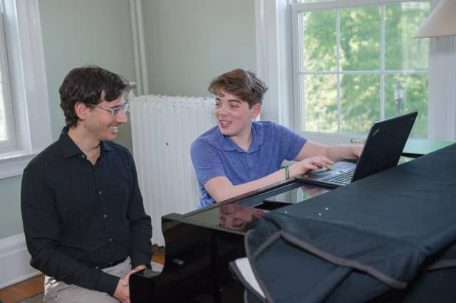 Concordia Conservatory Songwriting and Composition faculty, Dr. Matt Van brink with student Jonah Dichter. Student concerts are this week.
