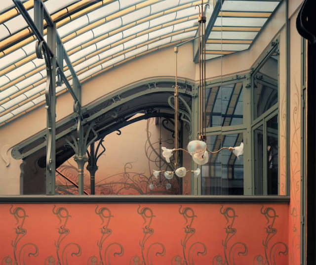 """The definition of the interior continues as reflected space in the mirrored upper wall of the ground-floor winter garden (of the Hôtel Tassel), as featured in """"Victor Horta: The Architect of Art Nouveau"""" by David Dernie and Alastair Carew-Cox. © Alastair Carew-Cox."""