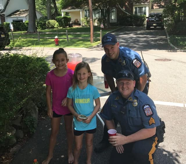 Park Ridge police officers stopped to support a local lemonade stand over the weekend.