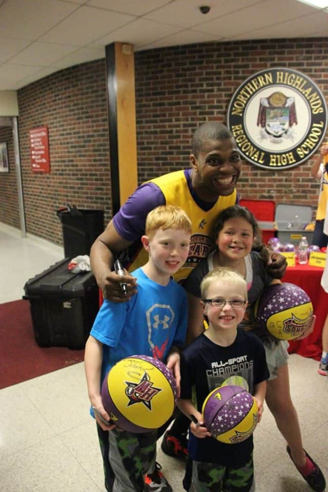 A Wizards player signed basketballs at 2014 event.