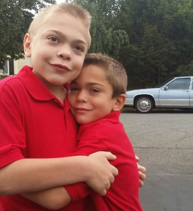 Jason, left, and Justin Leider hug. Their dad founded Let Them Be Little X2 Foundation after they were diagnosed with Hunter syndrome.
