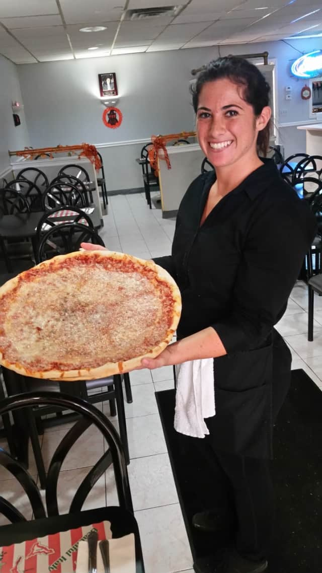 Jenna Throne of Saddle Brook brings out a pie for customers.