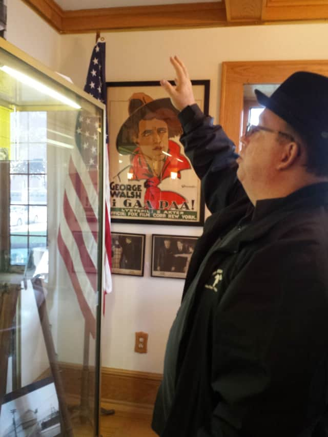 Tom Meyers, director of the Fort Lee Film Commission, checking one of the display cases.