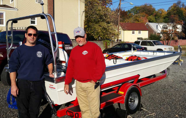 Rutherford Fire Chief Craig Scott and Councilman Jack Manzo with the new boat.