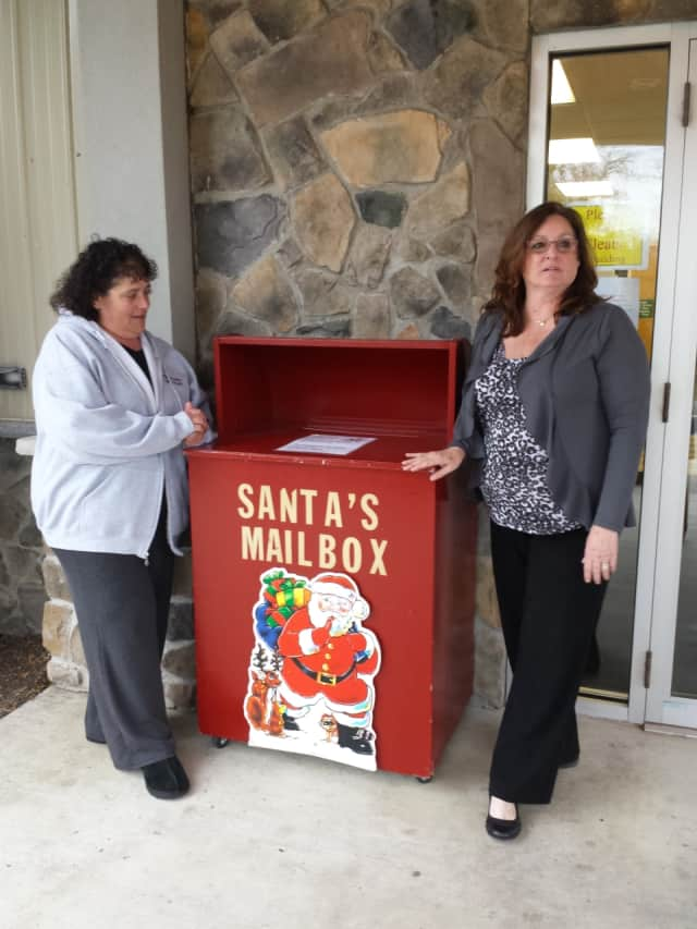 Gina Giardini and Cresskill Recreation Director Barbara Mann help collect letters to Santa.