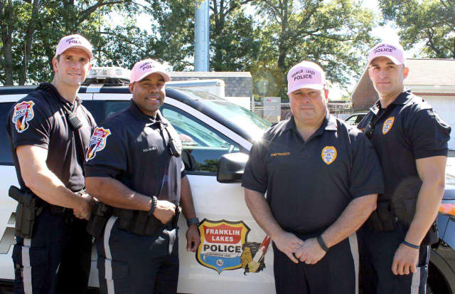 Standing Left to right: Officer Donald Wilson, Officer Brandon McNEIL, Chief Carmine Pezzuti and Sgt. Mark McCombs