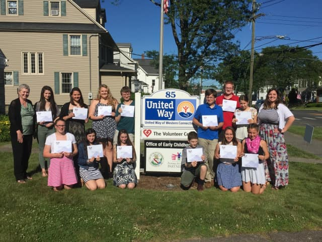 Twenty-three local youth were honored for their service with Youth Volunteer Corps of Western Connecticut. See end of story for identifications.