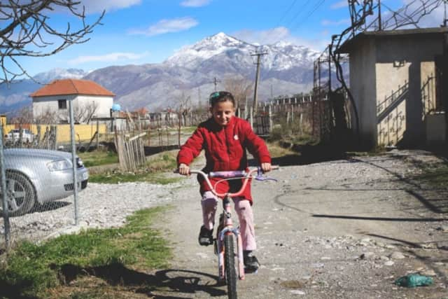 An Albanian girl rides her Pedals for Progress bike.