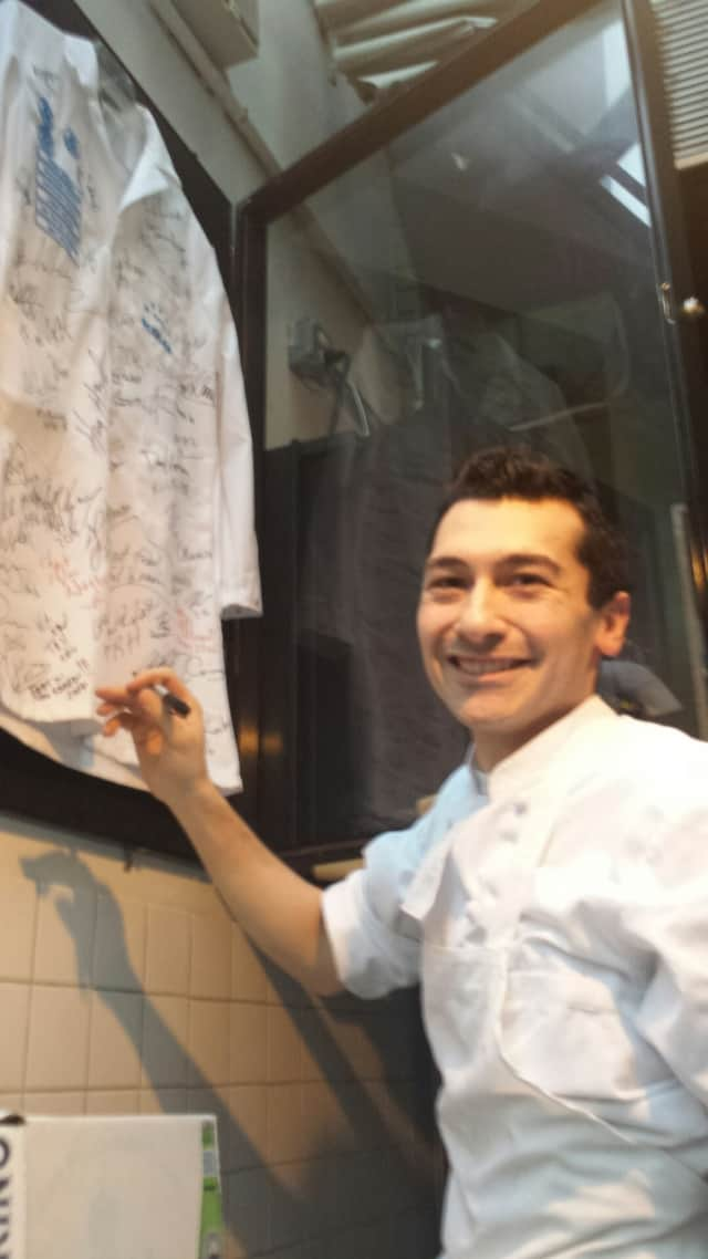 """Joseph Cuccia of Lodi signs the James Beard Foundation chef's jacket after being named a """"rising star."""""""