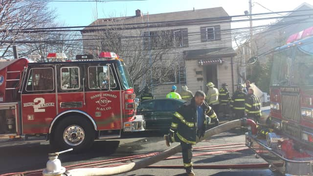Port Chester firefighters battle a blaze in the village in March.