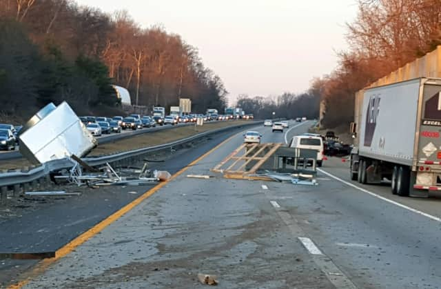 Vehicles were getting by on the right shoulder.
