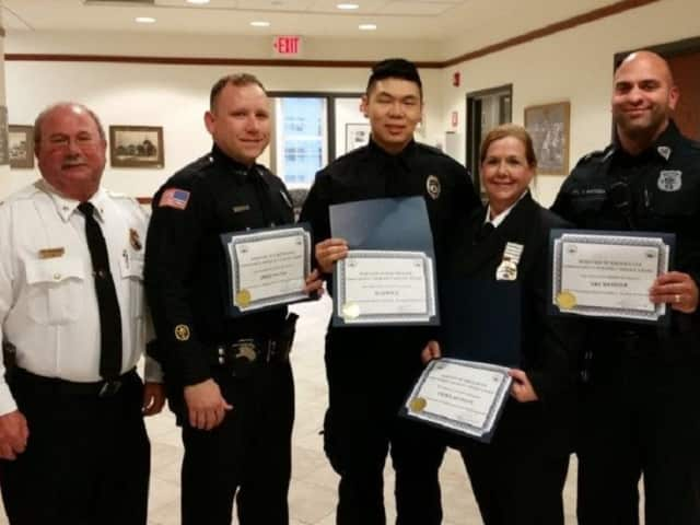 Edgewater Police Chief with heroes: Officers James Dalton and Dan Massuda, EMTs Cheryl Reynolds and Allen Guo.