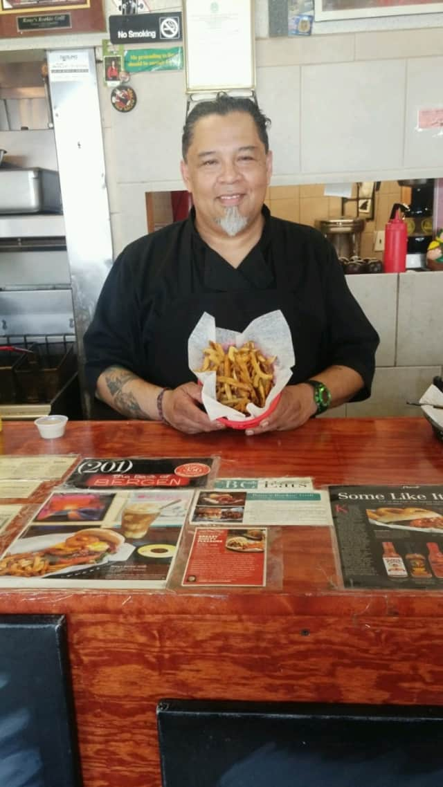 Rony Alvarado, owner of Bergenfield's Rony's Rockin' Grill, shows off his fries.