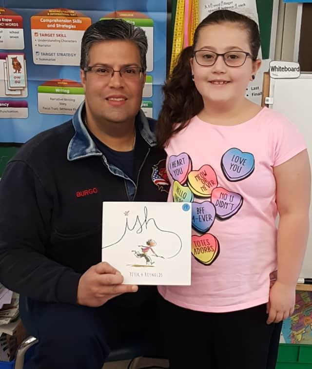 Hackensack Firefighter Roberto Burgos and daughter.