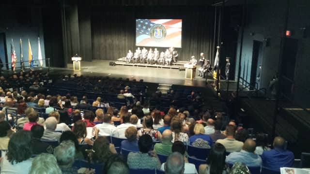 The deadline to apply for the Westchester County police officer exam is July 25. Hundreds of family members and fellow officers are shown at SUNY Purchase attending a graduation ceremony for the Westchester County Police Academy.