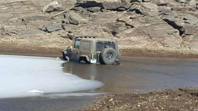 A man was arrested after driving and getting stuck in the Easton Reservoir, police said.