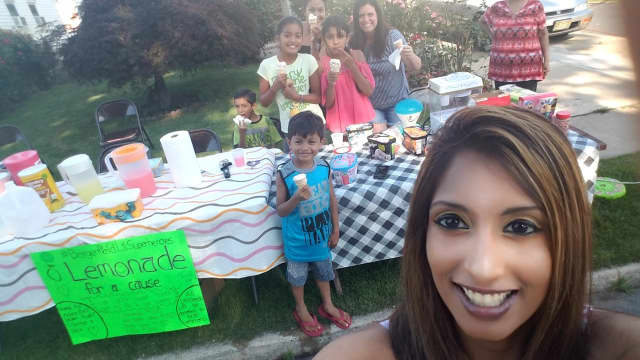 The DeSottos at their School Street lemonade stand Friday.