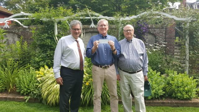 Robert Herber, president of the Rotary Club of Ridgefield; Charlie Taney, executive director of the NRVT; Joel Third, vice president of the Rotary Club of Ridgefield. Pictured at the Keeler Tavern garden.
