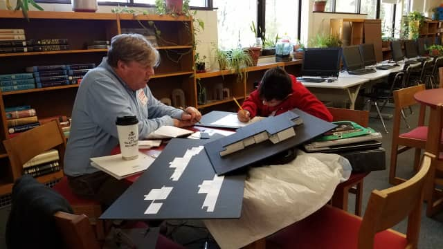 Bob Everett and mentee, Angel, working together on an architecture project, as part of the Norwalk Mentor Program.