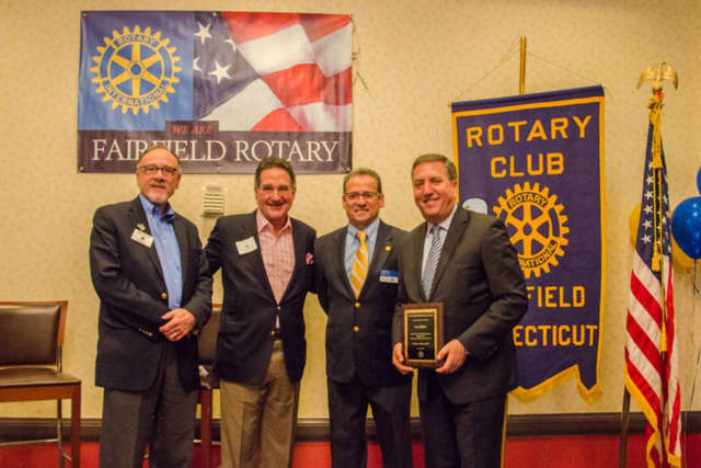 Saying thanks to Jon Miller of NBC Sports Group (far right) are current Fairfield Rotary Club President Gary Kealey, Emcee/ Moderator Mark Graham, and future Fairfield Rotary Club President Sam Topal.