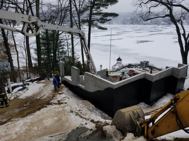 A construction worker injured at a home construction site on Forty Acre Mountain Road in Danbury on Thursday was pulled to safety by firefighters and tree workers.