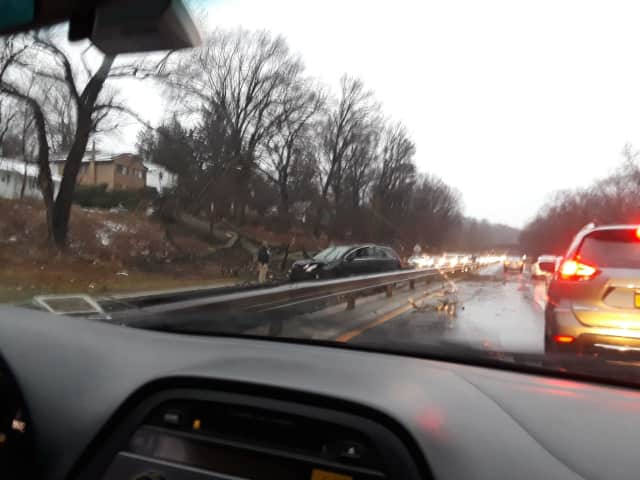 A downed tree -- one of hundreds in the area Friday -- on the Saw Mill River Parkway in Hastings-on-Hudson.