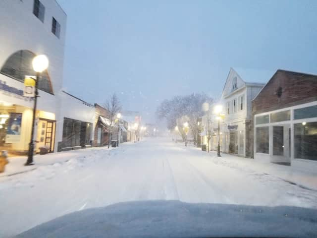 Westport's snowy Main Street looking quiet and serene Wednesday evening before trees started falling and power went out.