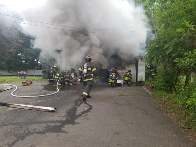 Danbury firefighters battle a garage fire.
