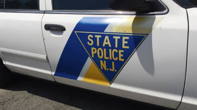 The trooper was taken to a local hospital with unspecified injuries and two suspects were taken into custody, state police said.