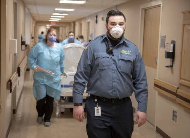 Brendan McLaughlin, 28, of Bergenfield, returned to work as a Holy Name Medical Center security guard Tuesday after being infected with coronavirus.