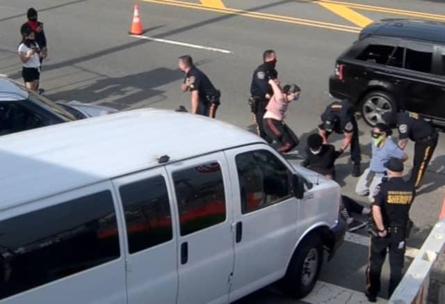 Protestors being taken into custody outside Bergen County Jail.