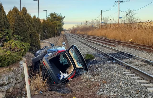 The SUV rolled and landed 50 feet off Route 17 in Carlstadt.