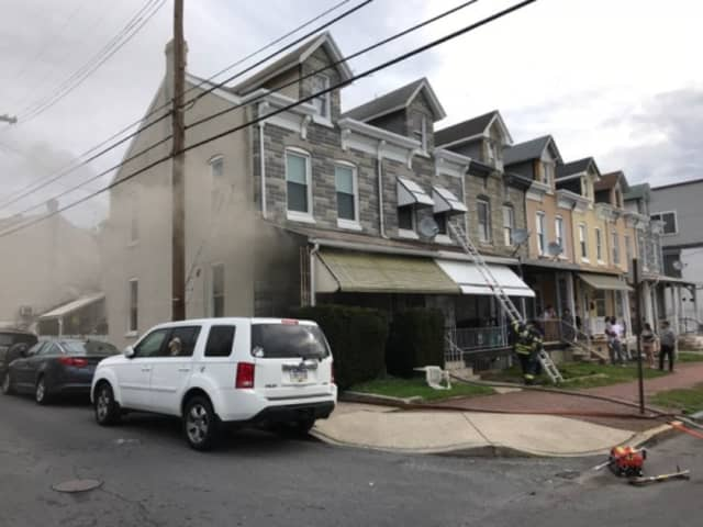 Reading firefighters rescued a woman from a smoke-filled house Friday morning.