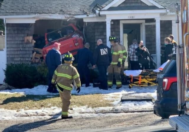 A pickup truck was launched into a home after the driver suffered a medical event.