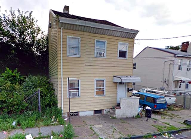 Paterson detectives raided this Mill Street house on Saturday.
