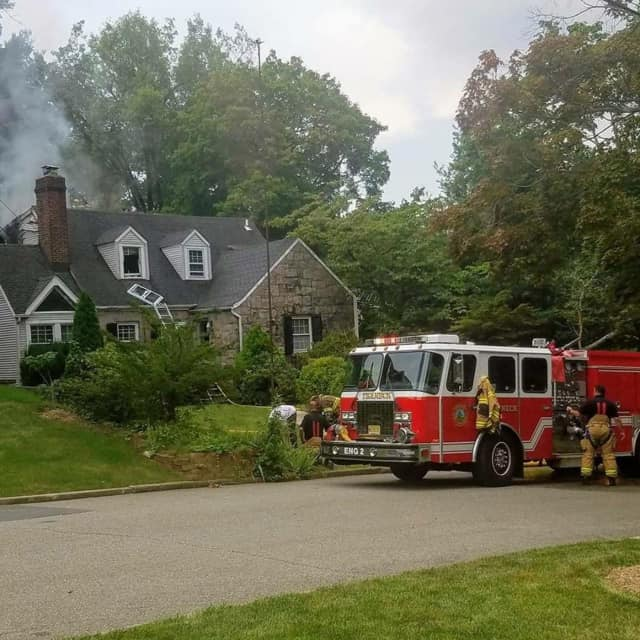 Hackensack firefighters assist on a Teaneck 2nd-alarm Wednesday.