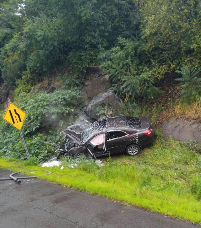 A car slammed into a rock wall on Saturday morning on the southbound side of Route 8 in Shelton.