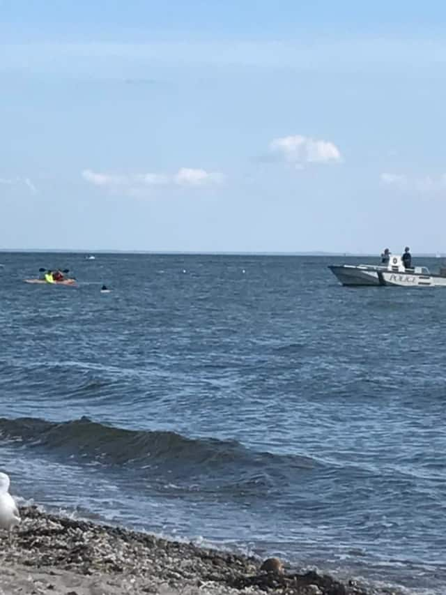 Westport Marine police come to the aid of a capsized kayaker off South Beach at Compo on Sunday.