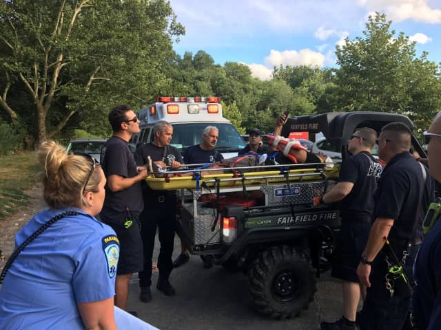 Fairfield first responders assist a cyclist who took a bad spill while trail riding in the Lake Mohegan open space area Sunday.