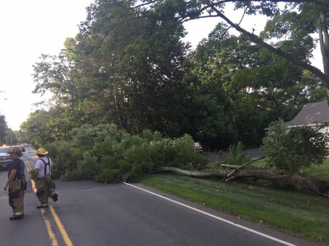 The Huntington Fire Co.  responds to a tree down — along with wires — on Huntington Street.