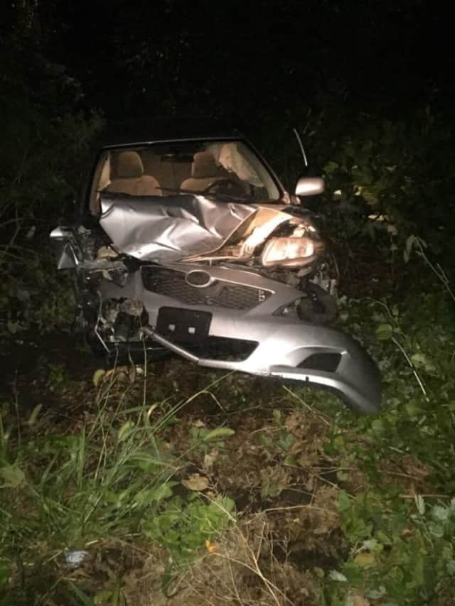 A car went off the road near 230 Weston Road in Weston early Sunday, breaking a telephone pole in half.