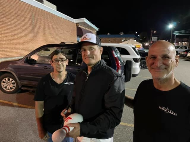 Woody Harrelson with Larry Perlitz and fans at the bowling alley.