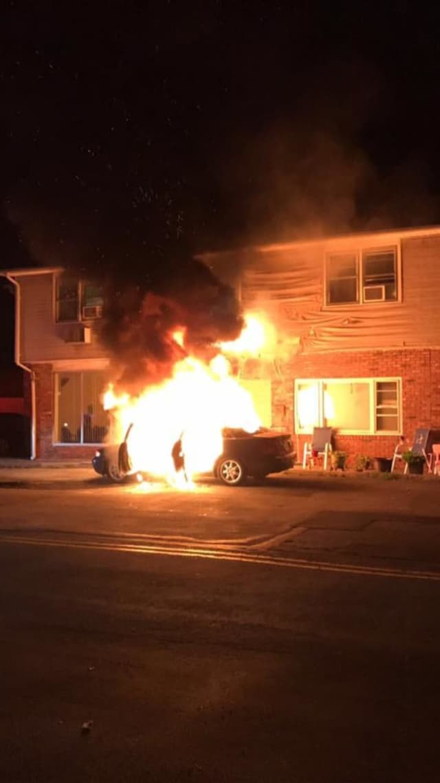 A car fire jumped to an apartment complex, scorching the outside of the building.