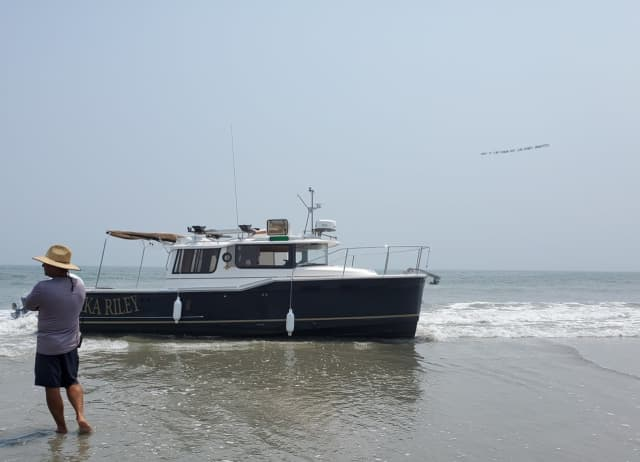 The incident happened near 13th and Beach, where swimmers got out of the water before the boat hit land around 12:30 p.m.